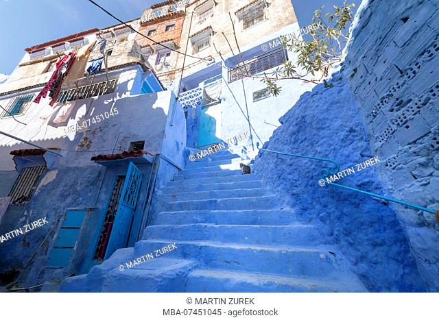 Buildings over a blue alley in Chefchaouen, Morocco, North Africa, Africa