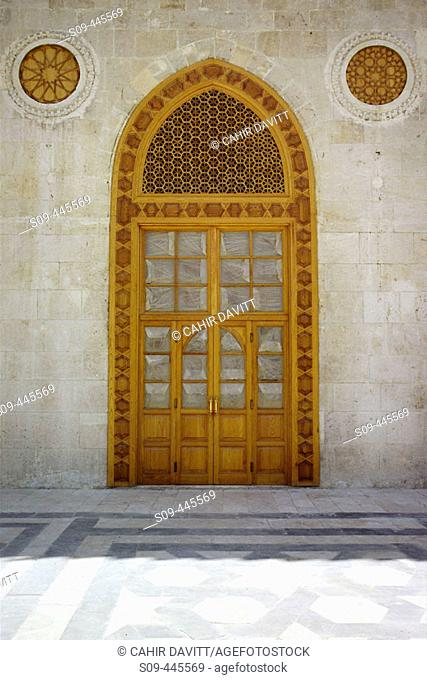 Detail of door to the prayer hall of the Umayyads' Mosque showing the ornate wooden latticework above. Halab, Syria