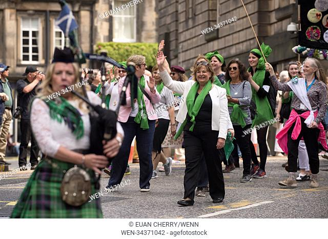 Thousands of women march through Edinburgh in tribute to 100 years of female suffrage. Processions are taken aprt throughout the country