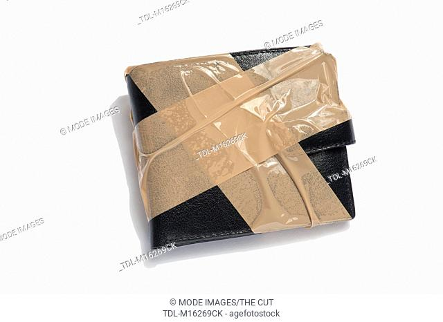A black leather wallet with brown tape around it