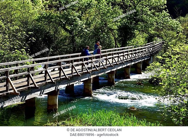 Two hikers on a bridge near Roski Slap, Krka Waterfalls, Krka National Park, Croatia