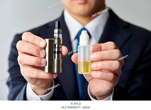 Young Japanese man smoking electronic cigarette
