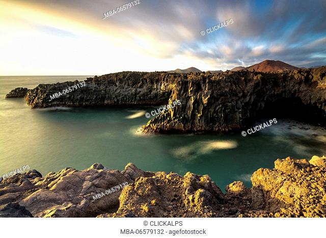 Los Hervideros - Yaiza, Lanzarote Los hervideros is characterized by rocky cliffs overlooking the Atlantic and in the background the volcanoes