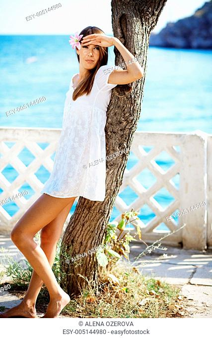 Beautiful female in summer vacation