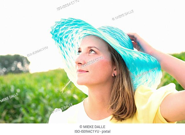 Close up portrait of adolescent girl in sunhat