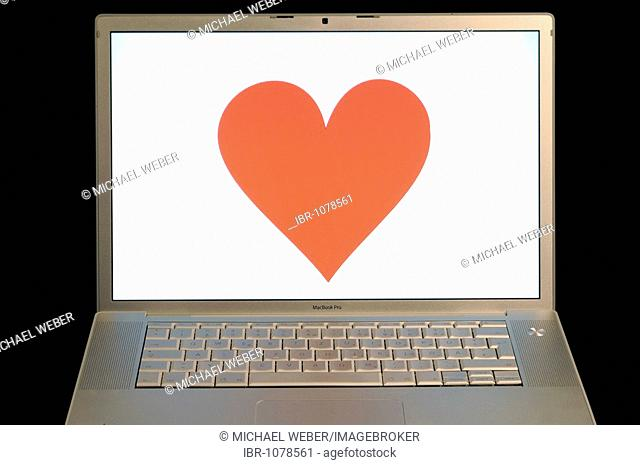 Heart on an Apple MacBook Pro screen, symbol for online dating