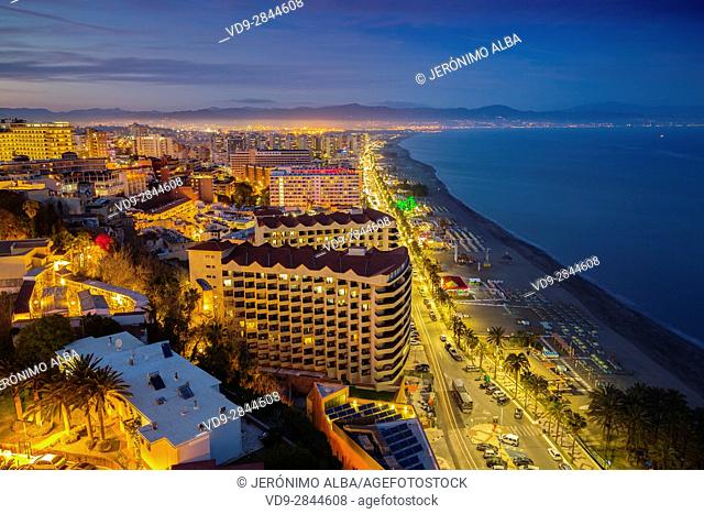Panoramic landscape at dusk beaches, hotels and El Bajondillo, Torremolinos. Malaga province Costa del Sol. Andalusia Southern Spain, Europe
