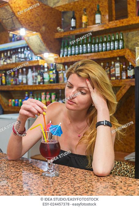 Pretty young woman with a cocktail bar