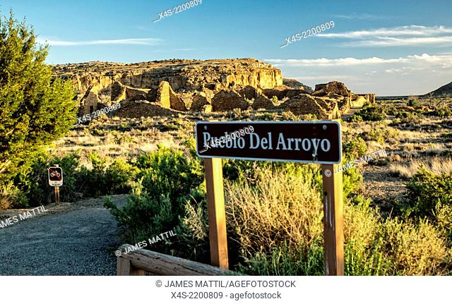 Warm rays of sunset illuminate the ruins at Chaco Canyon
