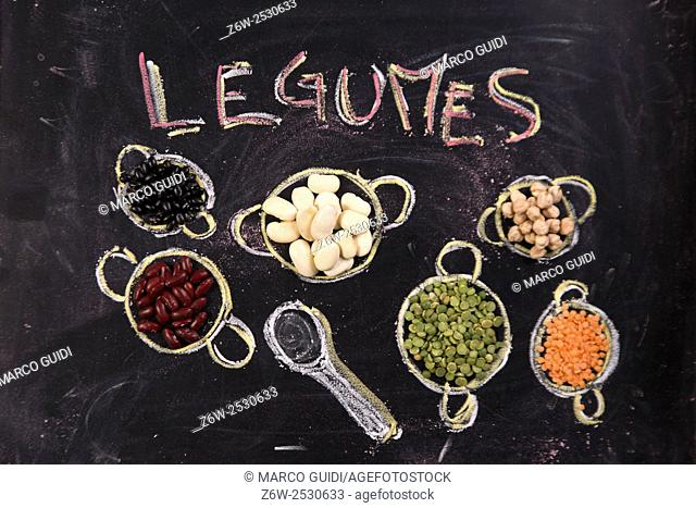 Presentation of varieties of vegetables in small containers drawn with chalk on blackboard