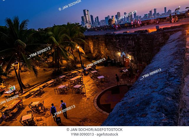 Tourists walk on and along the stone walls, surrounding the colonial Walled City, at twilight in Cartagena, Colombia, 15 December 2017