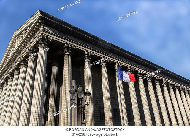 Paris, France - Side view of Eglise de la Madeleine with French national flag