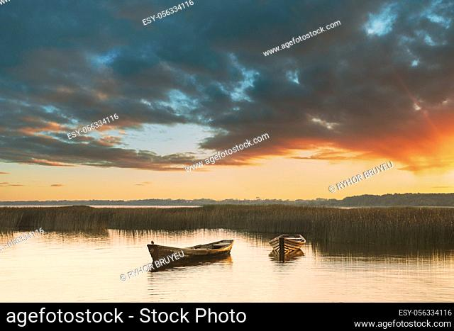 Wooden Rowing Fishing Boats In Beautiful Summer Sunset On Lake. Nature Of Belarus