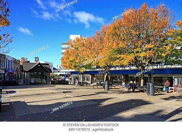 Autumn in St Jame's Street town centre shopping pedestrian precinct, Burnley Lancashire, England, UK