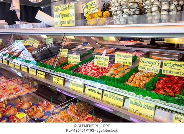 Counter with fresh seafood and snacks on display at fish stall along the Visserskaai in the city Ostend / Oostende, Belgium
