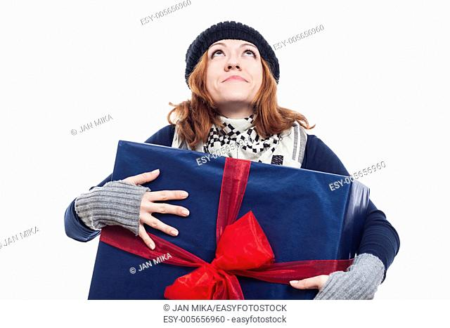 Thankful winter woman holding big present and looking up, isolated on white background