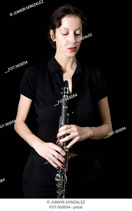 Woman holding a clarinet