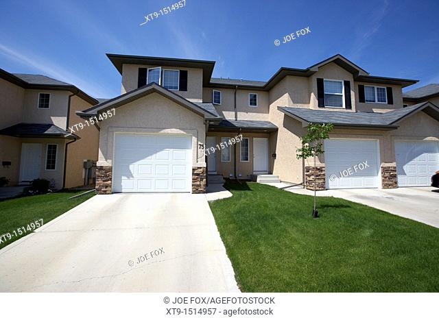 semi detached condominium properties starter homes on managed property Saskatoon Saskatchewan Canada