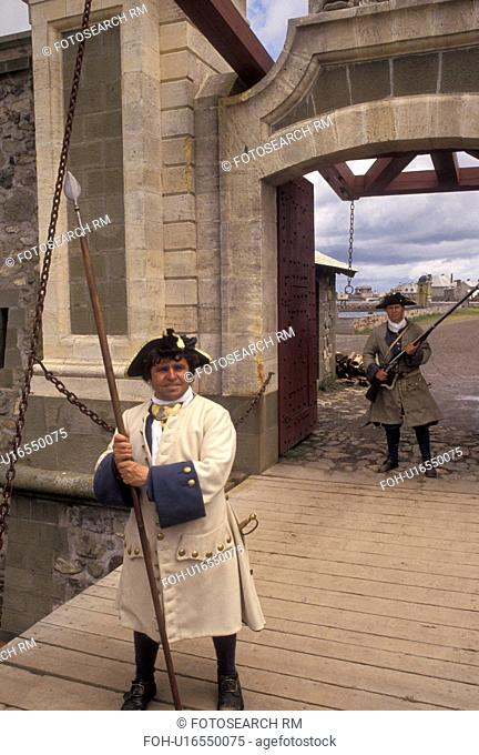 fortress, Cape Breton, Nova Scotia, NS, Canada, Atlantic Ocean, Guards dressed in authentic costumes at Dauphin Gate at the Fortress of Louisbourg National...