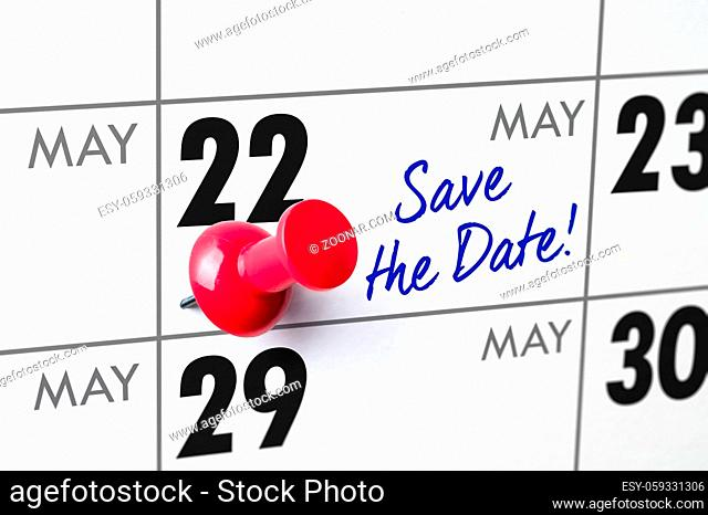 Wall calendar with a red pin - May 22