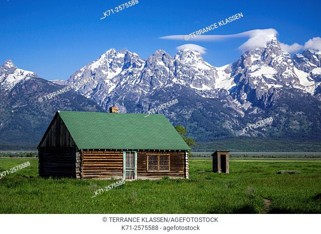 A Mormon Row barn and mountains in the Grand Teton National Park, Wyoming, USA