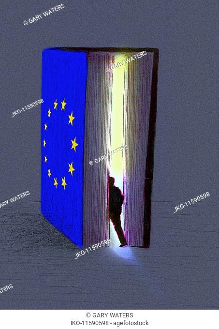 Businessman entering glowing European Union book