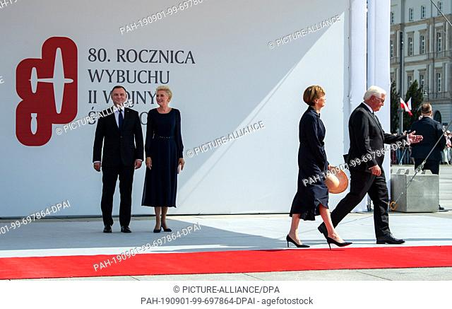 01 September 2019, Poland, Warschau: President Frank-Walter Steinmeier (right) and his wife Elke Büdenbender (2nd from right) are going to their seats at the...