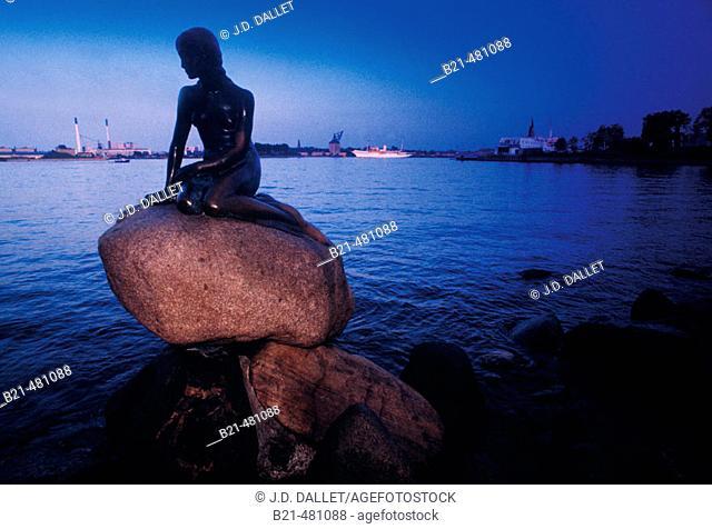 The 'Little Mermaid' at Copenhagen. Back the Royal ship, the 'Dannebro'. Denmark