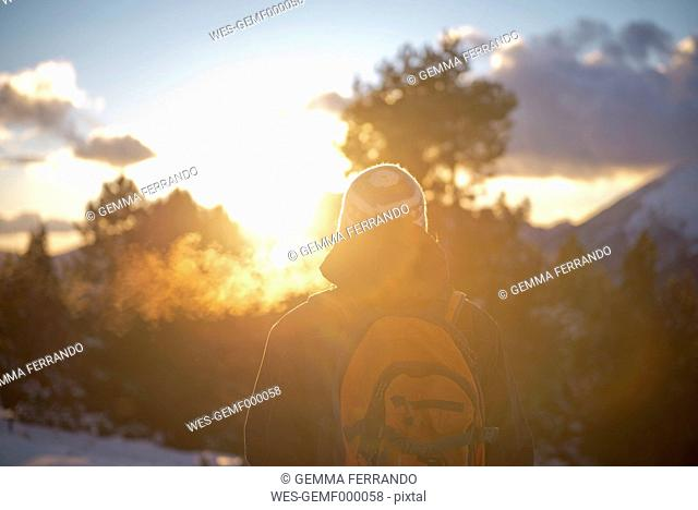 Spain, Cadi-Moixero Natural Park, man in the mountains at sunset