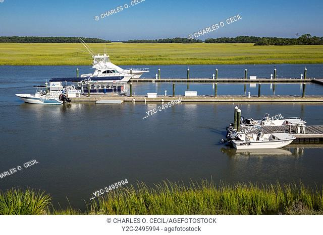Fripp Island, South Carolina, USA. Fishing Boats Anchored in Old House Creek, Wetlands in Background