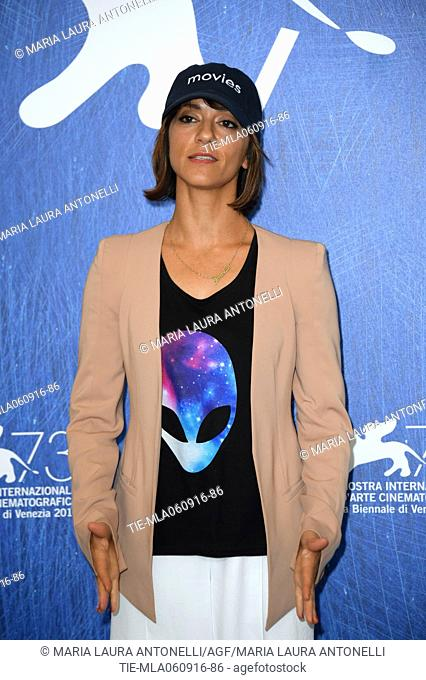 The director Ana Lily Amirpoured wears an hat and t-shirt on UFO during the photocall of film The bad batch at 73rd Venice Film Festival