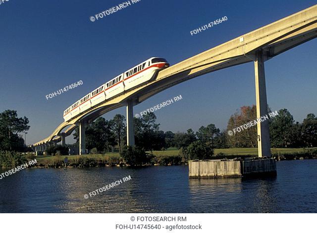 Disney World, FL, monorail, Orlando, Lake Buena Vista, Florida, Monorail travels across a bridge on an elevated single rail over a lake in Walt Disney World in...