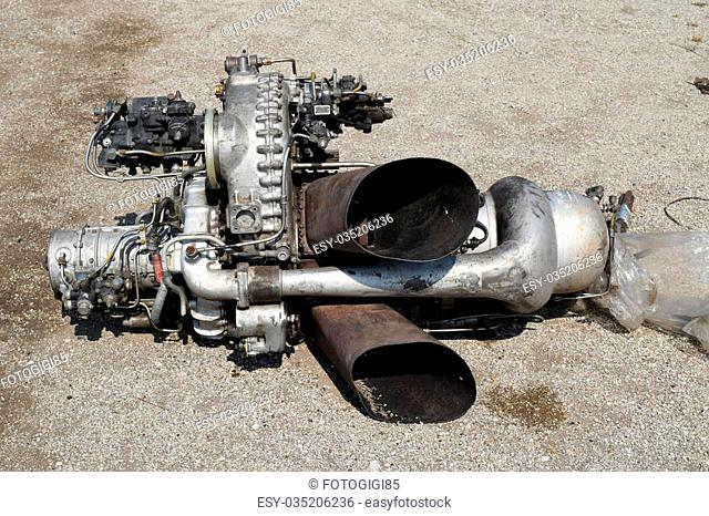 The helicopter engine which is pulled out outside. Spare parts and details of a design of helicopters