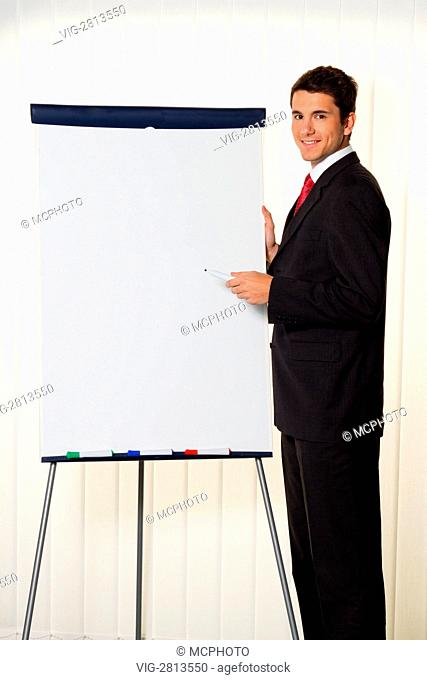 Successful businessman with a flip chart in a presentation - 01/01/2011