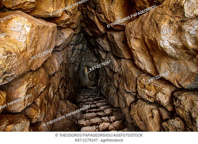 A roofed staircase that leads to an underground cistern inside the wals of the Mycenae citadel. Argolis, Peloponnese, Greece