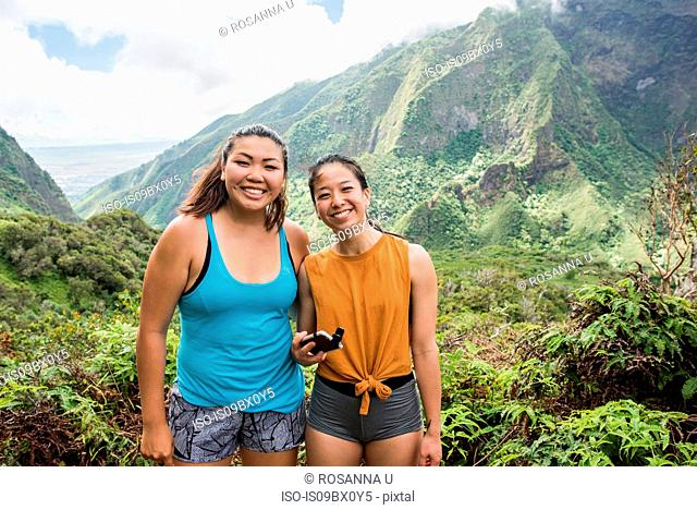 Hikers posing for photograph in rainforest, Iao Valley, Maui, Hawaii