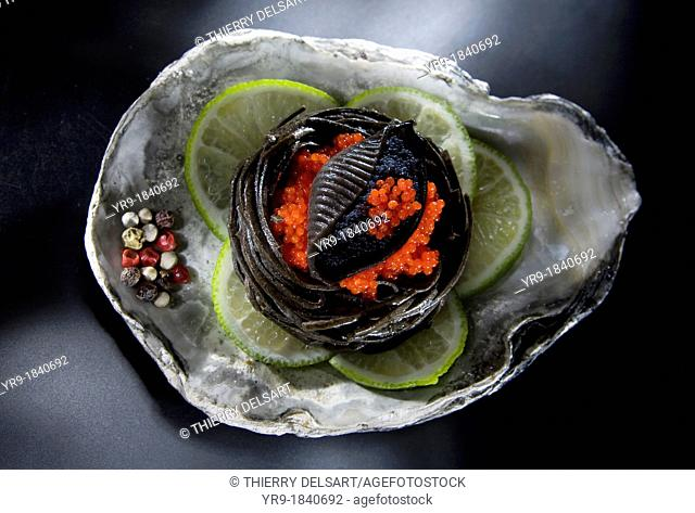 Catering recipe: Black and red roe on a black pasta nest and lime