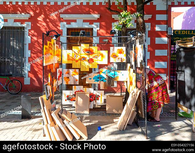 Cordoba Argentina January 4 setting up paintings exhibition in a craft market of Guemes district, located in the South of the city