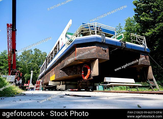"17 June 2021, Lower Saxony, Bad Zwischenahn: The passenger ship """"MS Oldenburg"""", cut in two lengthwise, lies on a slipway at the Zwischenahner Meer"