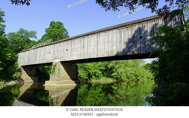 An old wooden covered bridge in summer, Pennsylvania, USA