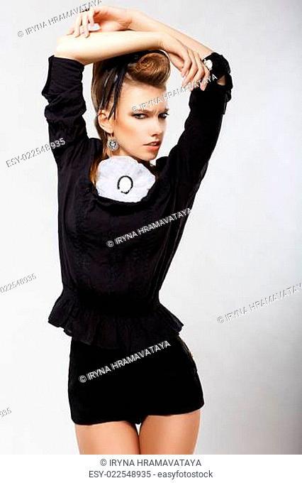 Elegance. Luxury. Ultramodern Charming Lady in Black Shorts. Fashion Style