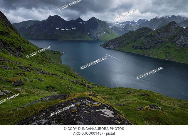 Scenic view of fjord and mountains on shore, Kirkefjord, Moskenesoya, Lofoten Islands, Norway