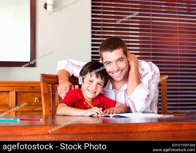 Nice father helping his son for homework