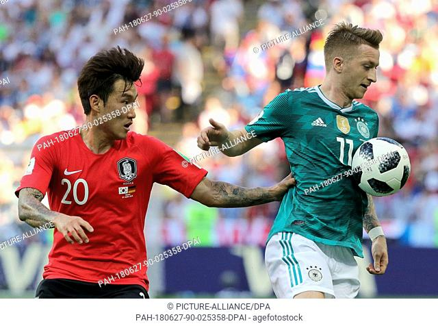 27 June 2018, Russia, Kazan: Soccer, FIFA World Cup, group F preliminary, Germany vs South Korea at the Kazan-Arena. Germany's Marco Reus (r) and South Korea's...
