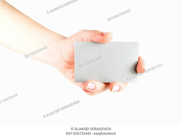 Blank business card in hand. Isolated with clipping path on white background. Template for design presentations and portfolios