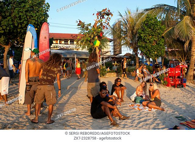Beach of Kuta at sunset. Surfing lessons. Bali. Kuta is a coastal town in the south of the island of Lombok in Indonesia