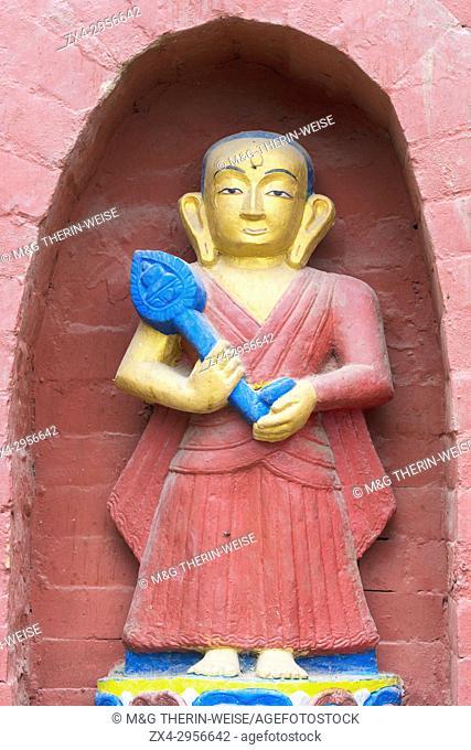 Statue decorating the base of the Bumisparsha mudra Buddha Statue, Swayambunath or Monkey Temple, Kathmandu, Nepal, Asia