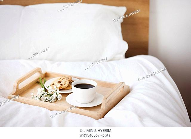 a trey full of breakfast on the bed