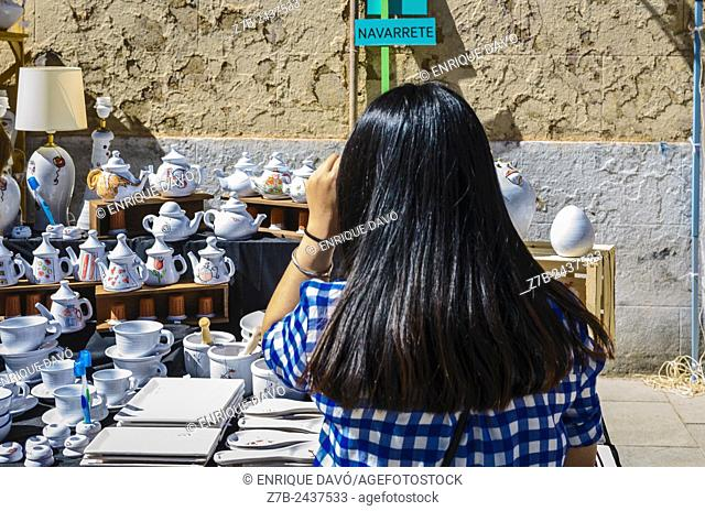 A black hair of a woman in a pottery fair, Madrid city, Spain