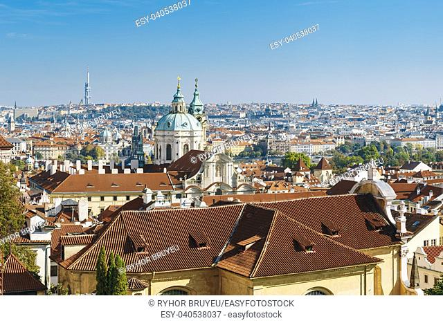 Aerial view of cityscape and St. Nicholas Church in Prague, Czech Republic